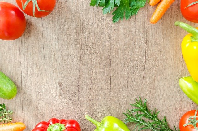 Fresh fruit and vegetables on a cutting board