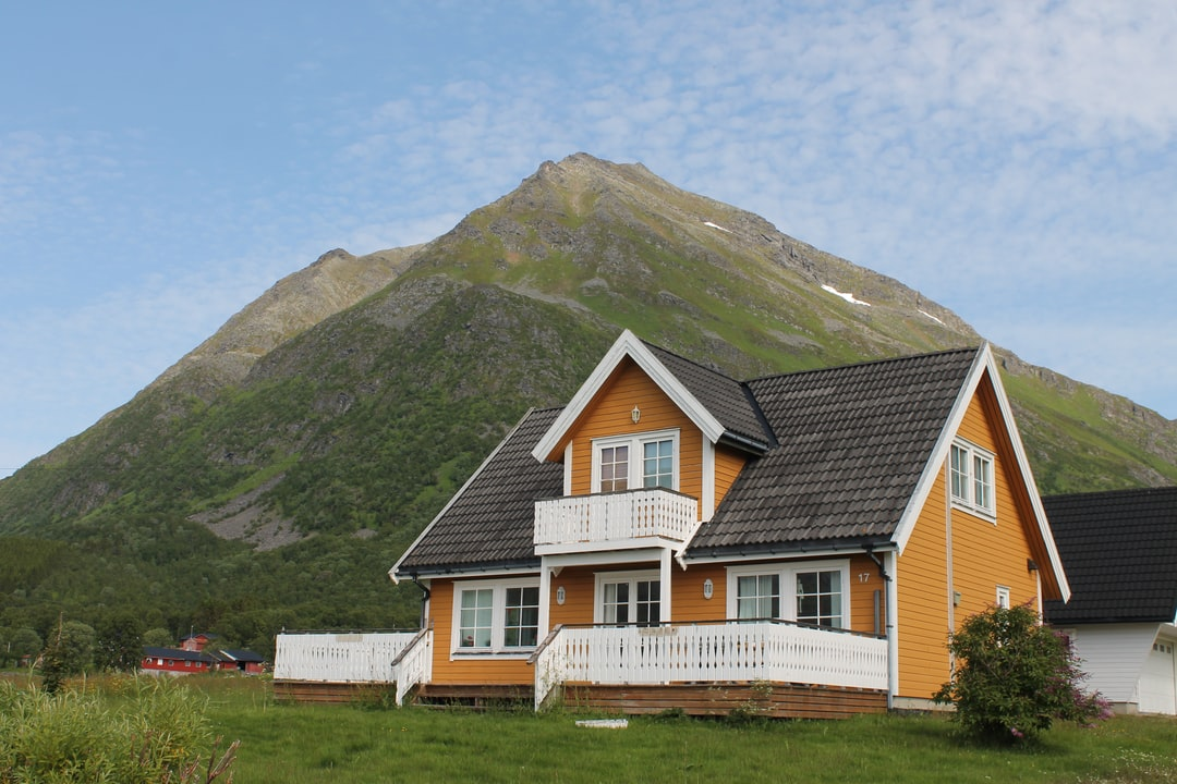 A house with a mountain in the background