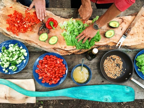 A close up of many different types of food on a wooden table